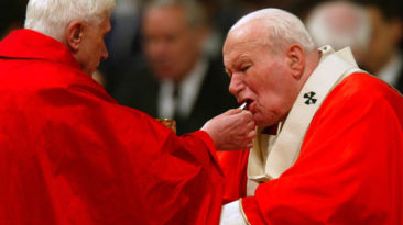 Joseph Cardinal Ratzinger giving Pope John Paul II Holy Communion.